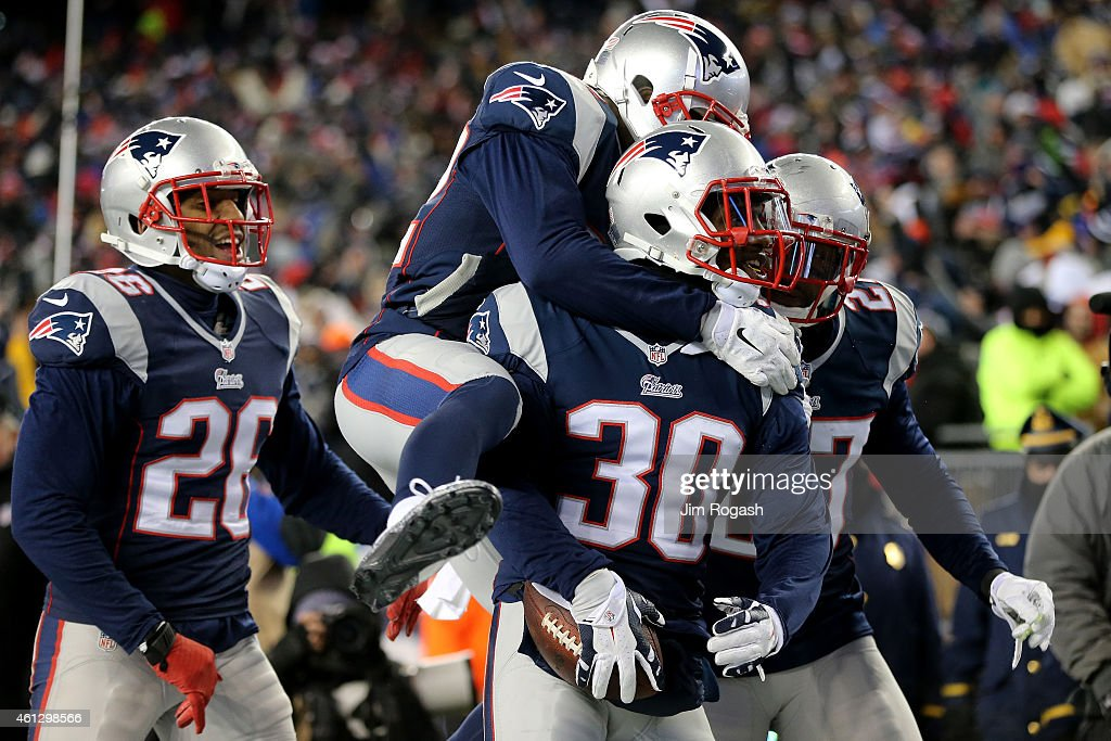 Duron Harmon of the New England Patriots reacts after intercepting a pass late in the game during the 2015 AFC Divisional Playoffs game against the...