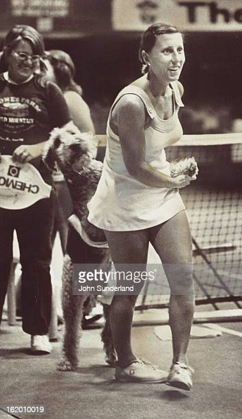 SEP 23 1975 SEP 24 1975 Durr Francoise Individuals Doggone Glad To Be Together Again Professional tennis player Francoise Durr is reunited with her...