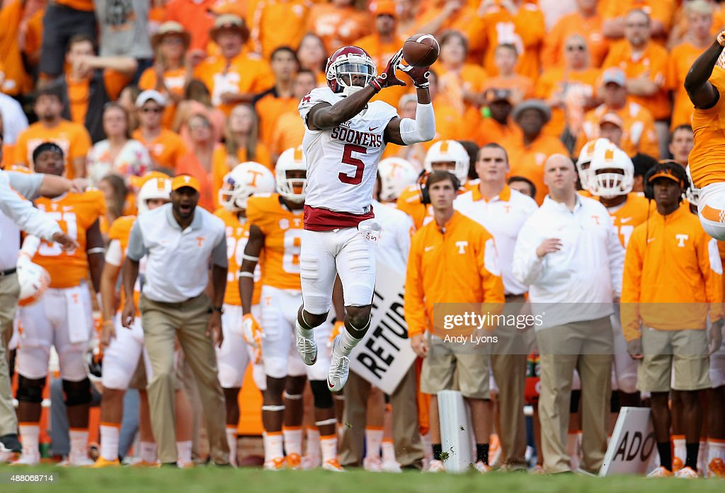 Durron Neal of the Oklahoma Sooners jumps up to catch the ball against the Tennessee Volunteers at Neyland Stadium on September 12 2015 in Knoxville...
