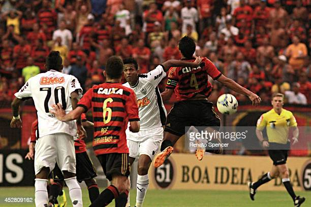 Durval of Sport Recife battles for the ball with Jo of Atletico MG during the Brasileirao Series A 2014 match between Sport Recife and Atletico MG at...