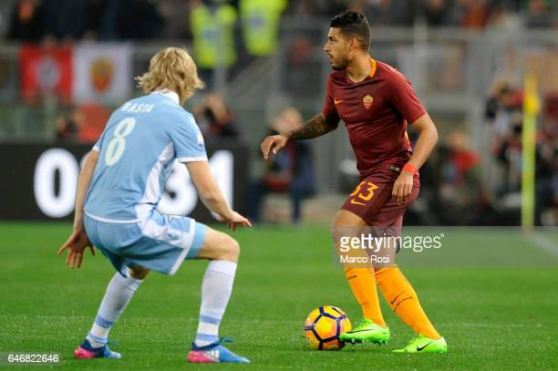 Dusan Basta of SS Lazio compete for the ball with Emerson Palmieri of AS Roma during the TIM Cup match between SS Lazio and AS Roma at Olimpico...