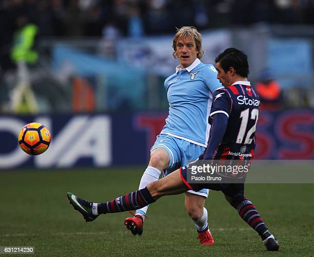 Dusan Basta of SS Lazio competes for the ball with Adrian Stojan of FC Crotone during the Serie A match between SS Lazio and FC Crotone at Stadio...