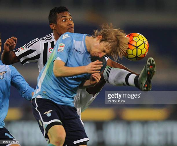Dusan Basta of SS Lazio competes for the ball with Alex Sandro of Juventus FC during the Serie A match between SS Lazio and Juventus FC at Stadio...