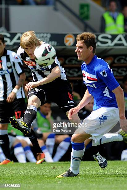 Dusan Basta of Udinese Calcio competes with Garcia Fernandes Renan of UC Sampdoria during the Serie A match between Udinese Calcio and UC Sampdoria...