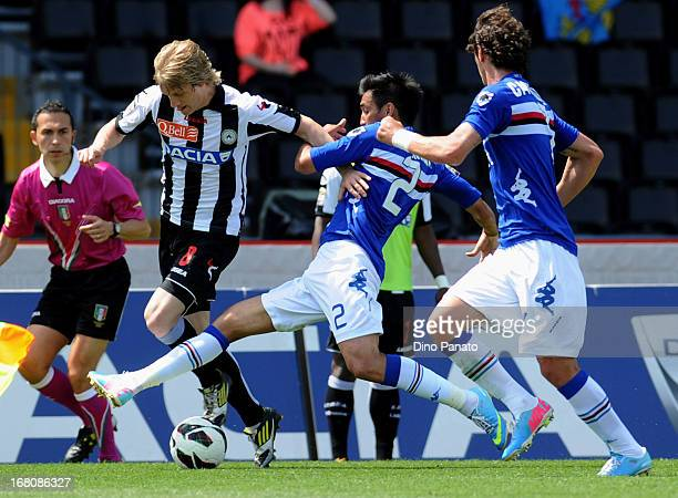 Dusan Basta of Udinese Calcio competes with Marcelo Alejandro Estigarribia of UC Sampdoria during the Serie A match between Udinese Calcio and UC...