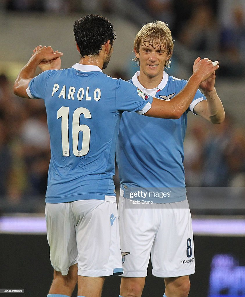 Dusan Basta (R) with his teammate <a gi-track='captionPersonalityLinkClicked' href=/galleries/search?phrase=Marco+Parolo&family=editorial&specificpeople=6474753 ng-click='$event.stopPropagation()'>Marco Parolo</a> of SS Lazio celebrates after scoring the sixth team's goal during the TIM Cup match between SS Lazio and Bassano FC at Olimpico Stadium on August 24, 2014 in Rome, Italy.
