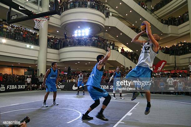 Dusan Domovic Bulut of team NoviSad AlWahda scores against team Manila Nnorth players during the FIBA 3X3 Manila leg at the Robinsons Mall in Manila...