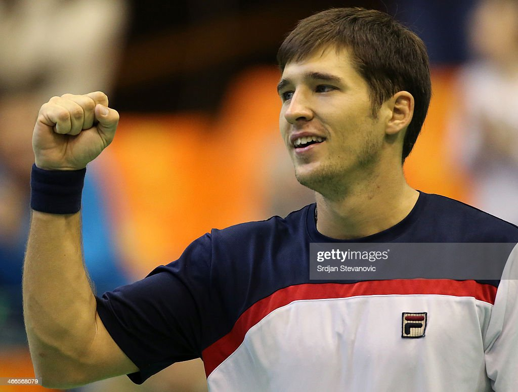 Dusan Lajovic of Serbia celebrate victory against Michael Lammer of Switzerland during the day three of the Davis Cup match between Serbia and Switzerland on February 02, 2014 in Novi Sad, Serbia.