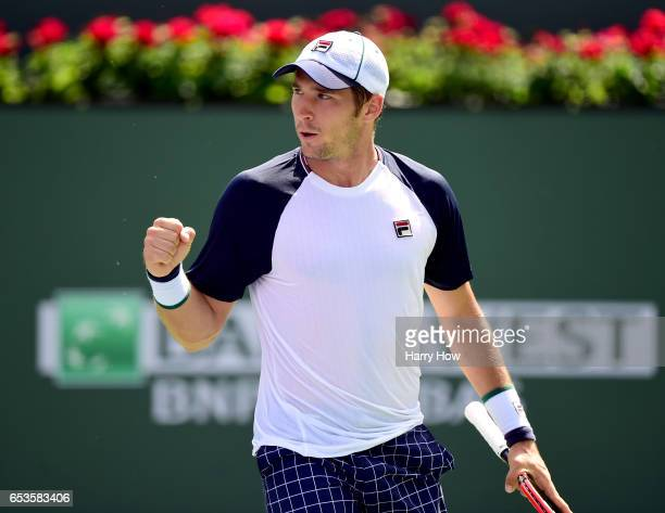 Dusan Lajovic of Serbia celebrates a game in his losing match to Pablo Carreno Busta of Spain during the BNP Paribas at Indian Wells Tennis Garden on...