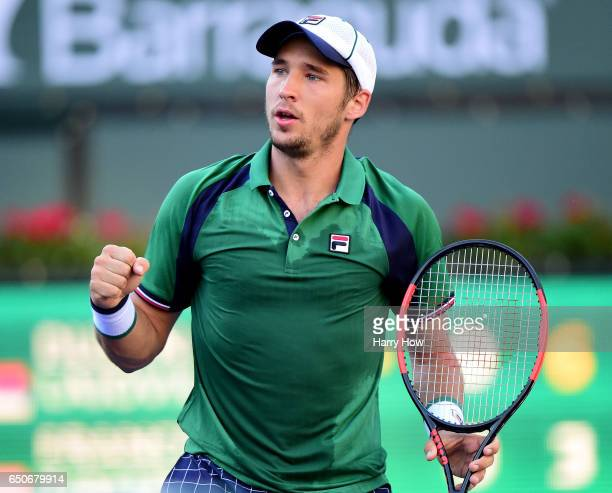 Dusan Lajovic of Serbia celebrates the first set in a straight set win over Frances Tiafoe at Indian Wells Tennis Garden on March 9 2017 in Indian...