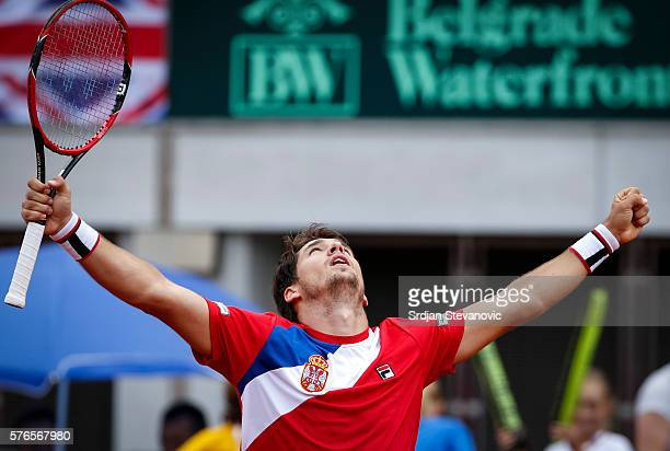 Dusan Lajovic of Serbia celebrates victory over James Ward of Great Britain after the Davis Cup Quarter Final match between Serbia and Great Britain...