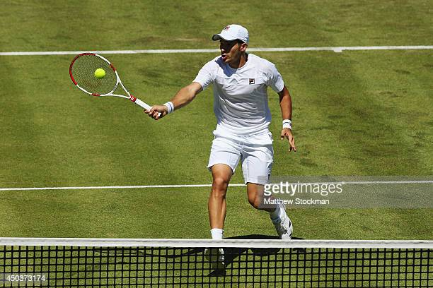 Dusan Lajovic of Serbia comes to the net against Feliciano Lopez of Spain during their Men's Singles match on day two of the Aegon Championships at...
