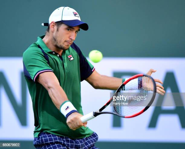 Dusan Lajovic of Serbia hits a backhand in his straight set win over Frances Tiafoe at Indian Wells Tennis Garden on March 9 2017 in Indian Wells...