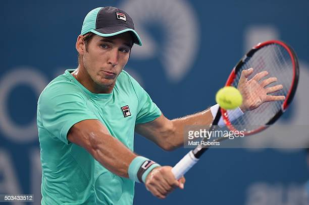Dusan Lajovic of Serbia plays a backhand against Radek Stepanek of Czech Republic during day three of the 2016 Brisbane International at Pat Rafter...