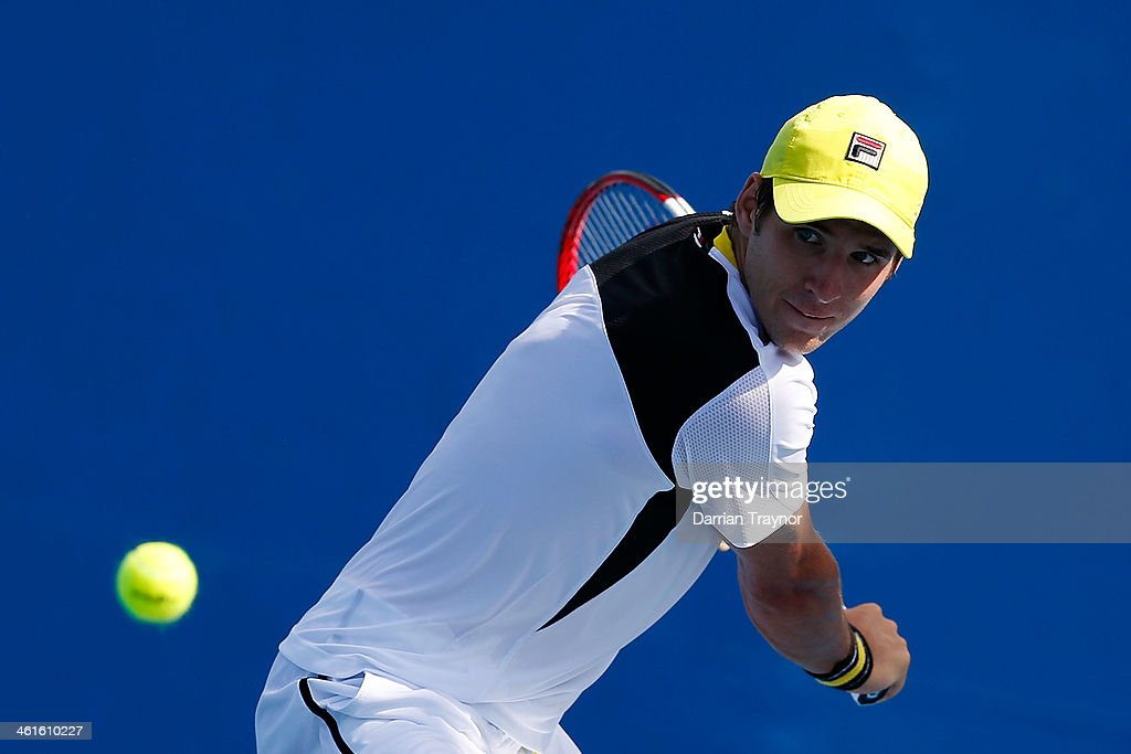 Dusan Lajovic of Serbia plays a backhand during qualifying for the 2014 Australian Open at Melbourne Park on January 10, 2014 in Melbourne, Australia.