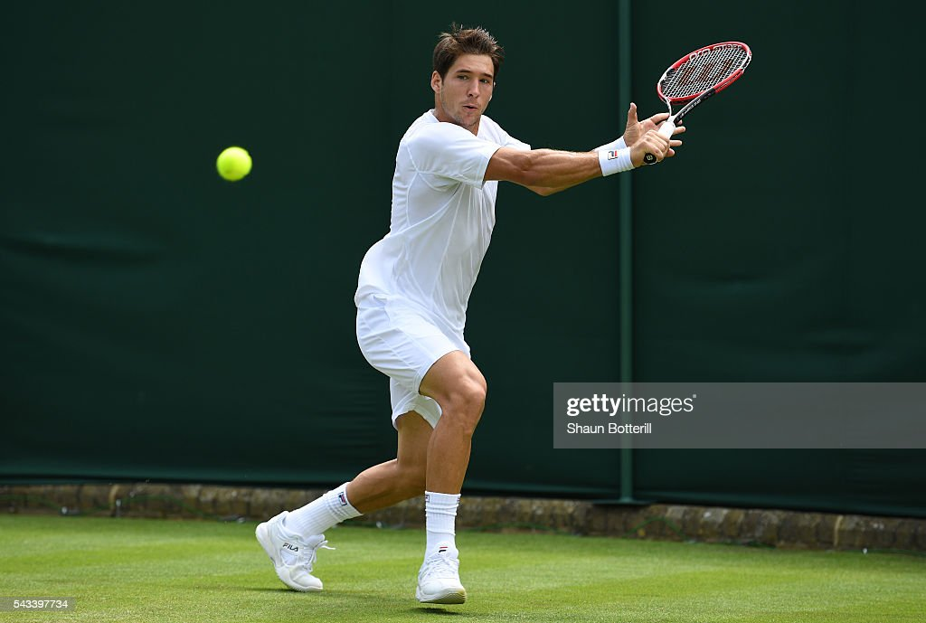 Dusan Lajovic of Serbia plays a backhand during the Men's Singles first round match against Dustin Brown of Germany on day two of the Wimbledon Lawn Tennis Championships at the All England Lawn Tennis and Croquet Club on June 28, 2016 in London, England.