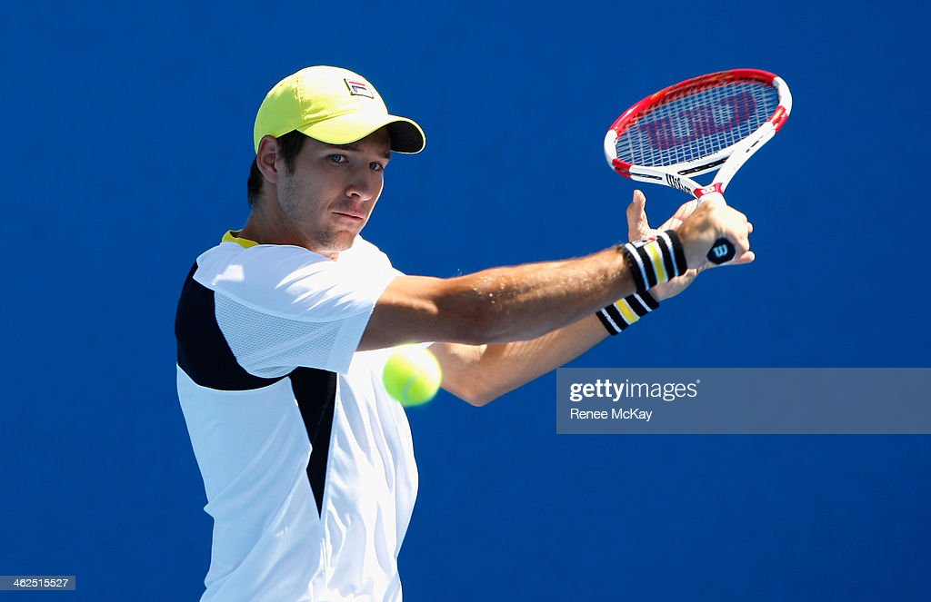 Dusan Lajovic of Serbia plays a backhand in his first round match against Lucas Pouille of France during day two of the 2014 Australian Open at Melbourne Park on January 14, 2014 in Melbourne, Australia.