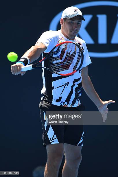 Dusan Lajovic of Serbia plays a backhand in his second round match against JoWilfried Tsonga of France on day three of the 2017 Australian Open at...