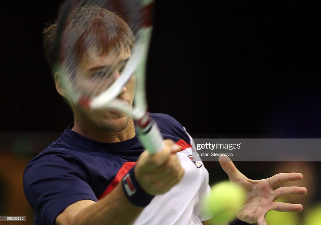 Dusan Lajovic of Serbia plays a forehand against Michael Lammer of Switzerland during the day three of the Davis Cup match between Serbia and Switzerland on February 02, 2014 in Novi Sad, Serbia.