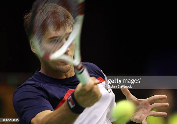Dusan Lajovic of Serbia plays a forehand against Michael Lammer of Switzerland during the day three of the Davis Cup match between Serbia and...