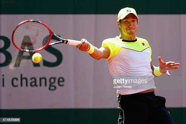 Dusan Lajovic of Serbia plays a forehand in his Men's Singles match against Stanislas Wawrinka of Switzerland during day four of the 2015 French Open...