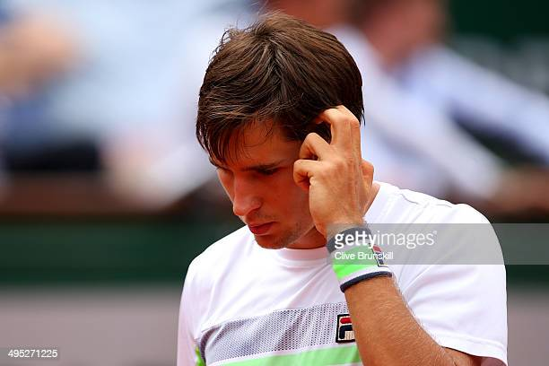 Dusan Lajovic of Serbia reacts in his men's singles match against Rafael Nadal of Spain on day nine of the French Open at Roland Garros on June 2...