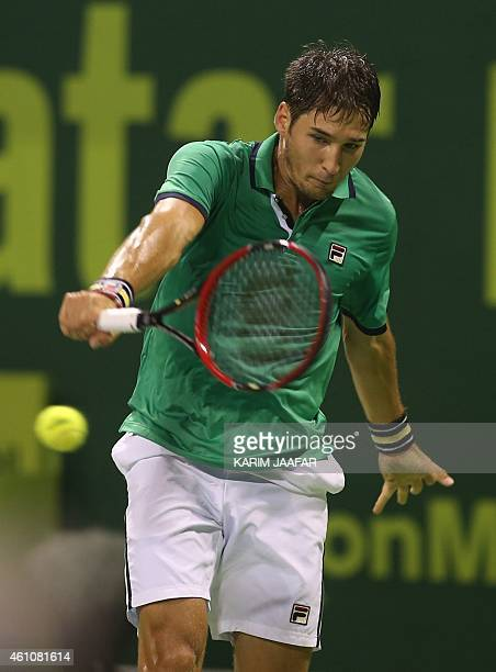 Dusan Lajovic of Serbia returns a ball to Novak Djokovic of Serbia during their tennis match in Qatar's ExxonMobil Open on January 6 in Doha AFP...