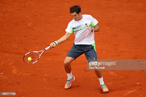 Dusan Lajovic of Serbia returns a shot in his men's singles match against Rafael Nadal of Spain on day nine of the French Open at Roland Garros on...