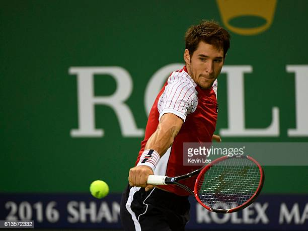 Dusan Lajovic of Serbia returns a shot to Kyle Edmund of Great Britain during their Final Qualifying Round at Qi Zhong Tennis Centre on October 9...