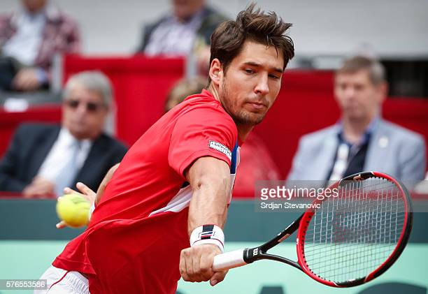 Dusan Lajovic of Serbia returns the ball to James Ward of Great Britain during the Davis Cup Quarter Final match between Serbia and Great Britain on...