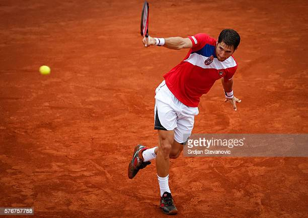 Dusan Lajovic of Serbia returns the ball to Kyle Edmund of Great Britain during day three of the Davis Cup Quarter Final match between Serbia and...