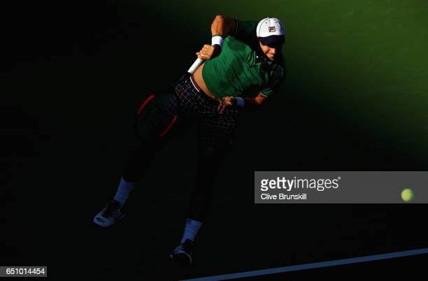 Dusan Lajovic of Serbia serves against Frances Tiafoe of the United States in their first round match during day four of the BNP Paribas Open at...