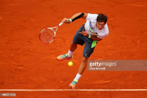 Dusan Lajovic of Serbia serves in his men's singles match against Rafael Nadal of Spain on day nine of the French Open at Roland Garros on June 2...