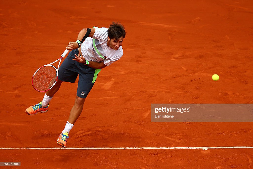 Dusan Lajovic of Serbia serves in his men's singles match against Rafael Nadal of Spain on day nine of the French Open at Roland Garros on June 2, 2014 in Paris, France.