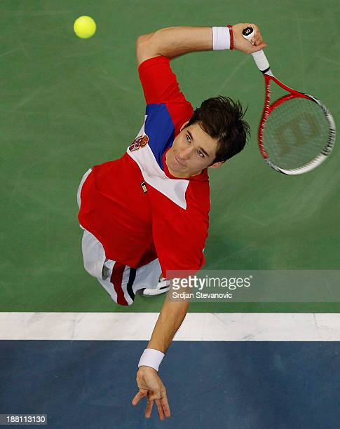 Dusan Lajovic of Serbia serves the ball to Tomas Berdych of Czech Republic during the day one of the final Davis Cup match between Serbia and Czech...
