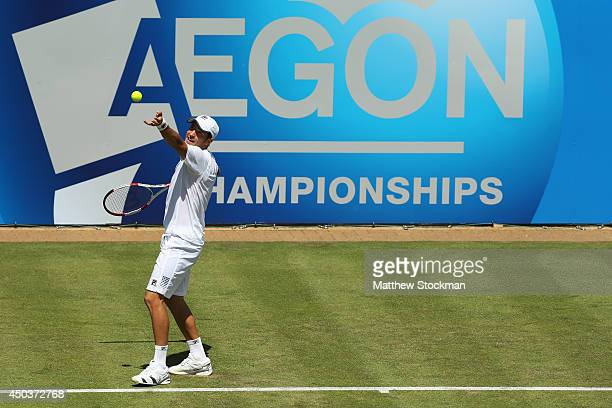 Dusan Lajovic of Serbia serves to Feliciano Lopez of Spain during their Men's Singles match on day two of the Aegon Championships at Queens Club on...