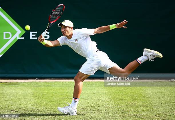 Dusan Lajovic of Serbia stretches for a forehand during his match against John Isner of the USA during Day 1 of The Boodles Tennis Event at Stoke...