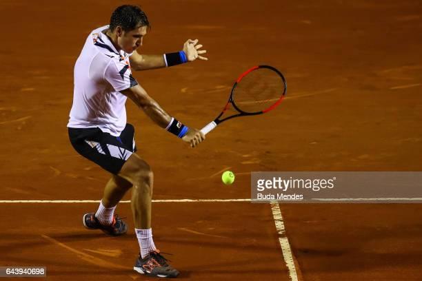 Dusan Lajovic of Serbian returns a shot to Dominic Thiem of Austria during the ATP Rio Open 2017 at Jockey Club Brasileiro on February 22 2017 in Rio...