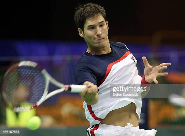 Dusan Lajovic plays a forehand against Stanislas Wawrinka of Switzerland during day one of the Davis Cup match between Serbia and Switzerland on...