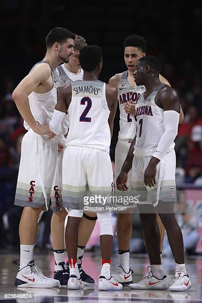 Dusan Ristic Lauri Markkanen Kobi Simmons Chance Comanche and Rawle Alkins of the Arizona Wildcats talk during the second half of the college...