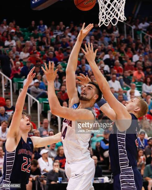 Dusan Ristic of Arizona shoots the ball over Jock Landale and Dane Pineau of St Mary's during the 2017 NCAA Men's Basketball Tournament held at...