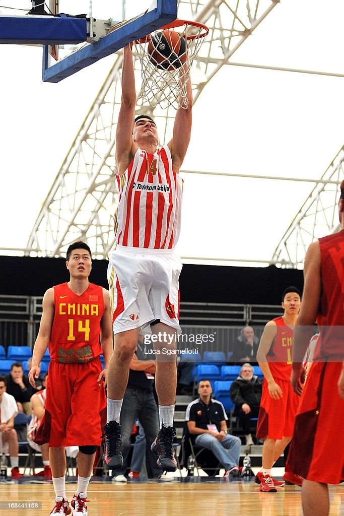 Dusan Ristic #14 of Crvena Zvezda Telekom Belgrade dunks during the Nike International Junior Tournament game between Team China Vs Crvena Zvezda Telekom Belgrade at Soccerdome on May 9, 2013 in London, United Kingdom.