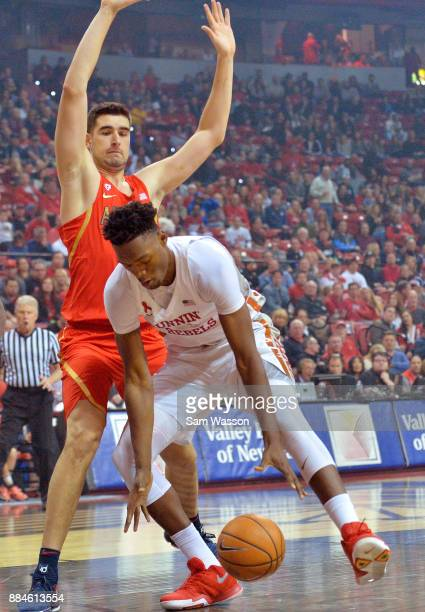 Dusan Ristic of the Arizona Wildcats guards Brandon McCoy of the UNLV Rebels during their game at the Thomas Mack Center on December 2 2017 in Las...