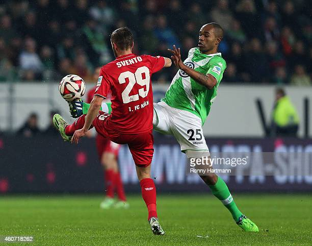 Dusan Svento of Koeln and Naldo of Wolfsburg vie during the Bundesliga match between VfL Wolfsburg and 1 FC Koeln at Volkswagen Arena on December 20...