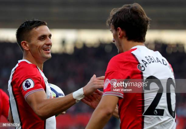 Dusan Tadic celebrates with Manolo Gabbiadini during the Premier League match between Southampton and Newcastle United at St Mary's Stadium on...