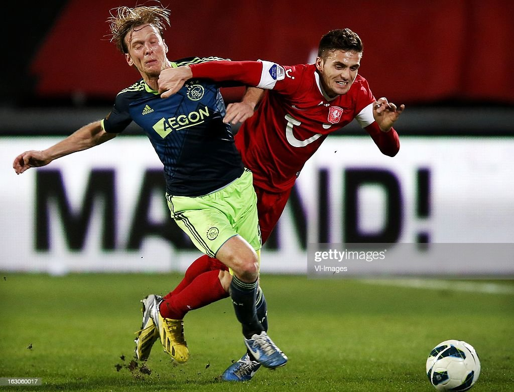 Dusan Tadic (R), Christian Poulsen (L) during the Dutch Eredivisie match between FC Twente and Ajax Amsterdam at the Grolsch Veste on march 02, 2013 in Enschede, The Netherlands