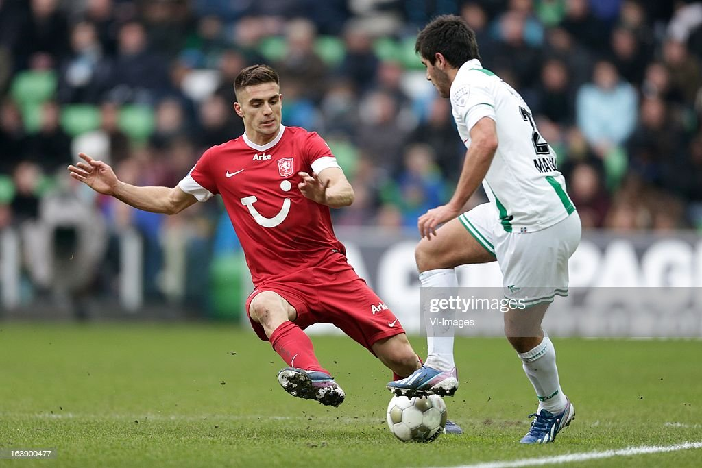 Dusan Tadic of FC Twente (L) Stefano Magnasco of FC Groningen (R) during the Dutch Eredivisie match between FC Groningen and FC Twente at the Euroborg Stadium on march 17, 2013 in Groningen, The Netherlands