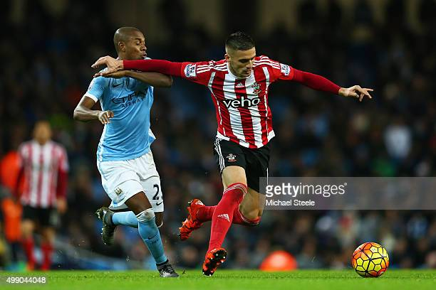 Dusan Tadic of Southampton and Fernandinho of Manchester City compete for the ball during the Barclays Premier League match between Manchester City...