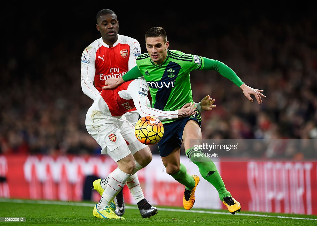 Dusan Tadic of Southampton and Hector Bellerin of Arsenal compete for the ball during the Barclays Premier League match between Arsenal and Southampton at the Emirates Stadium on February 2, 2016 in London, England.