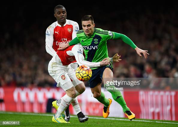 Dusan Tadic of Southampton and Hector Bellerin of Arsenal compete for the ball during the Barclays Premier League match between Arsenal and...